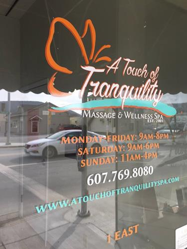 Custom die-cut door lettering for A Touch of Tranquility Massage & Wellness Spa