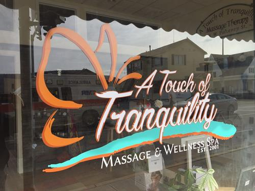 Custom die-cut window lettering for A Touch of Tranquility Massage & Wellness Spa