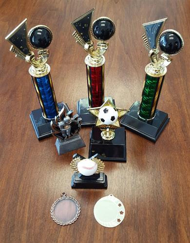 Trophies & Medals.  We have variety of items to choose from.
