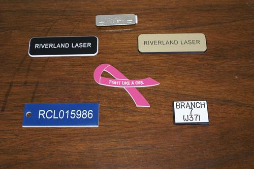 Plastic name plate or name tags.  Lots of colors to choose from.
