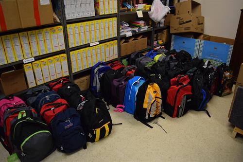 Filled backpacks from the backpack program - ready to be delivered to the schools!