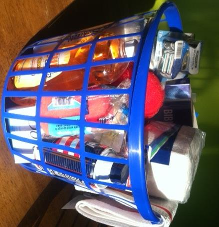 """Welcome Home"" basket full of personal care and cleaning supplies."