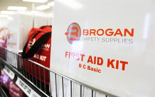 First aid kits stocked on the shelves.