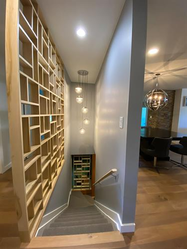 Modern Ranch Design - Custom Wall Partitions Top and Bottom of Stairs to Lower Level
