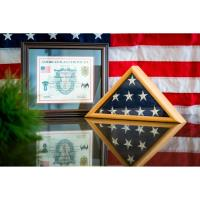 Local Green Beret Presents Howard Hospitality with Flag of the United States