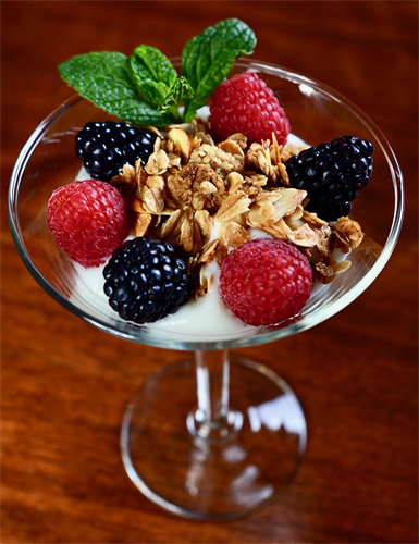 Sample fruit course - yogurt, fruit, and granola parfait
