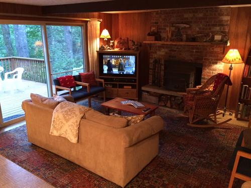 Cozy 1 - Liviing area w/wood stove and river view!