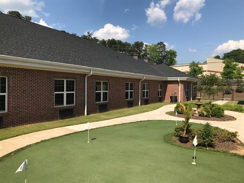 A putting green is available for some outside therapy.