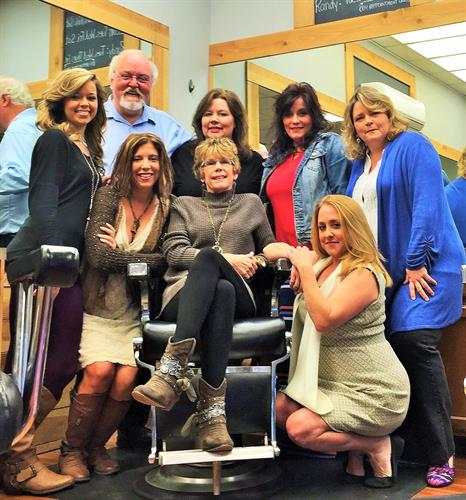 Owner and friend, Donna McLaurin, surrounded by the ones who love her most! She has been cutting hair at Vestavia Barber Shop since 1978.