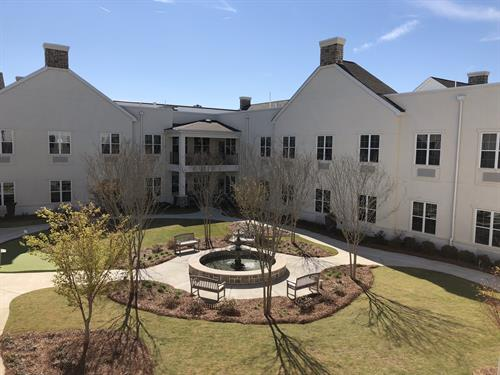 The courtyard is manicured frequently and includes porches or balconies.