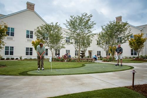 The putting green can also be used in our beautiful courtyard.