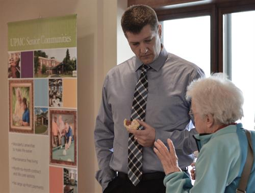Scott G. Rainey, D.O., Tri Rivers orthopedic back and neck surgeon, talks with an attendee of a spring 2016 outreach event at Cumberland Woods Village
