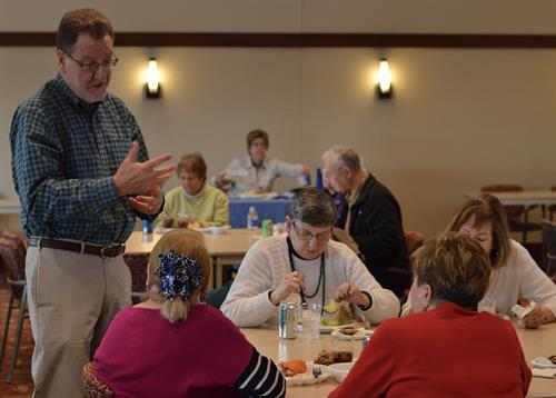 Michael W. Weiss, M.D., Tri Rivers hip and knee reconstruction surgeon, speaking with participants at a spring 2016 outreach event at Cumberland Woods Village