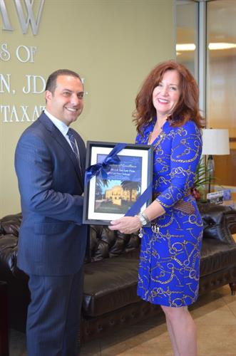 Ronson J. Shamoun receives recognition from the University of San Diego, presented by Debbie Rider, commending him for his involvement at the University.