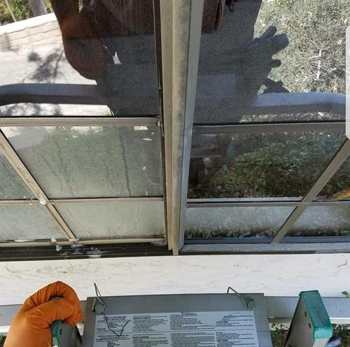 Window Cleaning with one side that has not been restored and the other side that has been restored