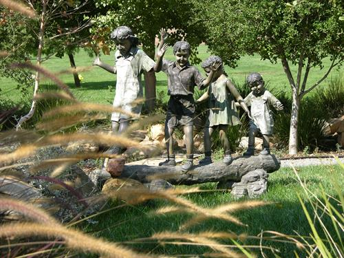 Bronze Children in Whispering Waters