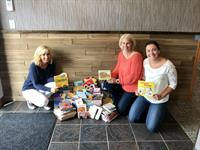 "TrueWealth team collecting books for the ""Do Good"" tour."