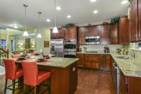 The kitchen of the McKinley floor plan featured at SummerTree in Crown Point