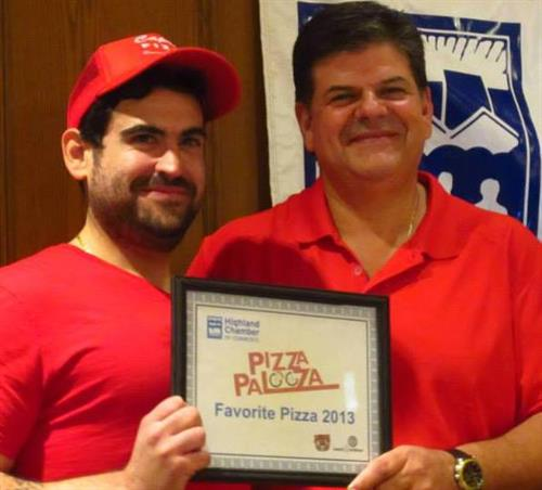 Ben and Len Ciannamea accepting first place at the inaugural Pizza Palooza in HIghland.