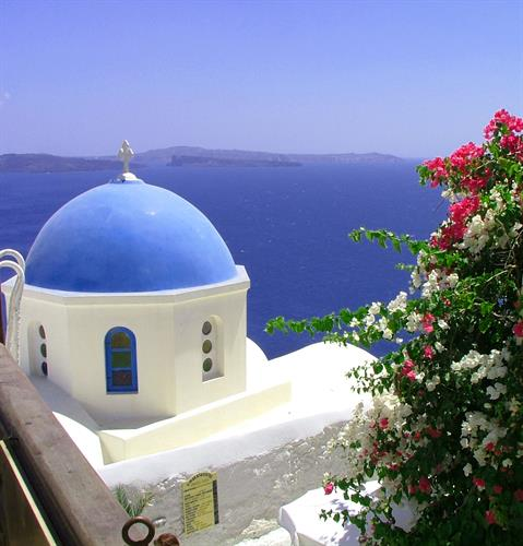 Santorini, on the island of Thira, Greece!!  Best times to visit are late April or early November!