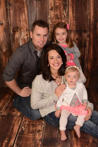 Chris and his wife, Lisa, with their 2 daughters
