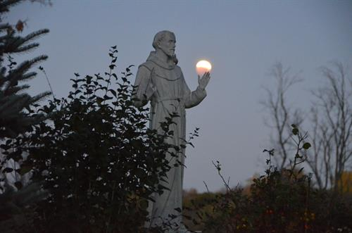 Gallery Image close_up_of_francis_statue_during_eclipse.jpg