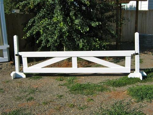 "Gate jumps are nice looking obstacles for going over, and easy to move. (24""x10' gate jump on 4' schooling standards)"