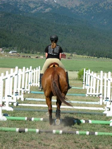 Setting up ground pole exercises in your arena or field is a great way to make flatwork more interesting.