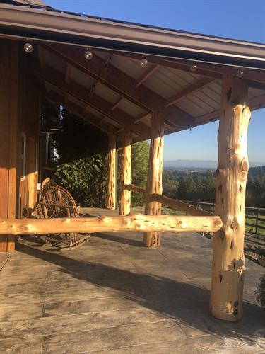 Renovation of an existing barn for use as an event venue included adding rest rooms, remodel of tack room, and this porch to take advantage of the view