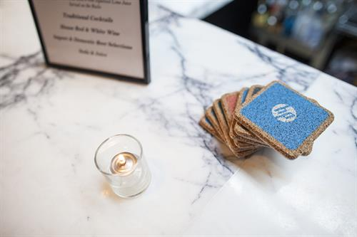 Ask about Added Amenities, like these Custom Coasters.