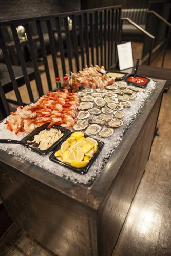 Ask about Adding Specialty Buffets, like this Raw Bar or a Carving Station.