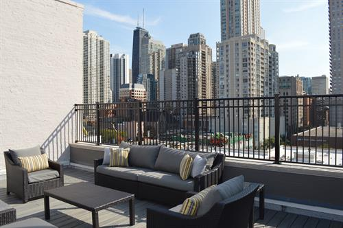 Enjoy several options of seating on our sundeck with expansive city views