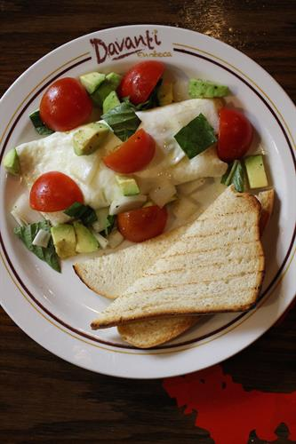 dana's omelette ...  egg whites + sheep's milk feta +  avocado + tomato + onion + basil + toast