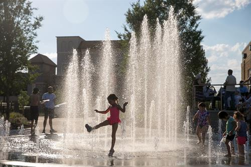 Enjoying the splash pad at the Town Green