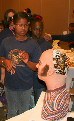DFW ATW GREATMINDS girl with robot