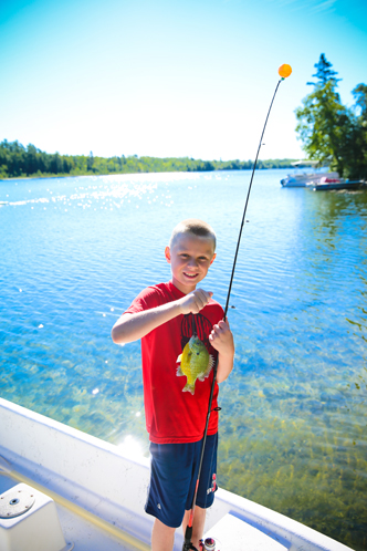Gallery Image Boy_with_Sunfish_at_Half_Moon_Trail_Resort.jpg