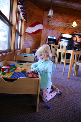 Gallery Image Girl_Playing_with_Toys_in_Lodge_at_Half_Moon_Trail_Resort_X2.jpg