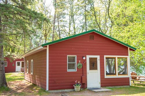 Cabin 2 exterior. All of our cabins are a gorgeous cabin red with northwoods green roofs.