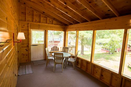 Screen porch of Cabin 10. Every cabin has