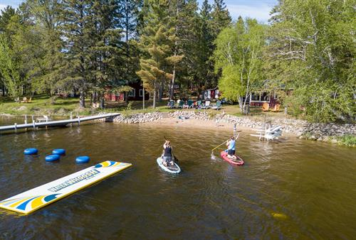 Swimming beach area includes water whoosh, paddle boards, kayaks, water bicycle, and water trampoline.