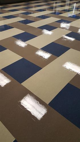 Vinyl tile refinishing