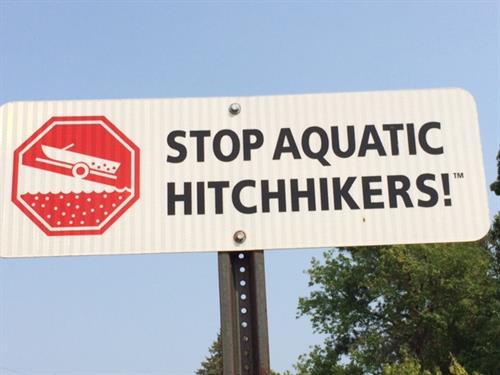 Stop Aquatic Hitchhikers signs along county roads remind boaters to prevent AIS.
