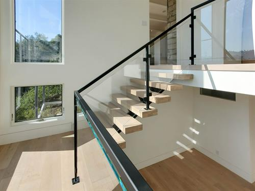 Custom floating stairs designed by G Design and built by G Family Inc