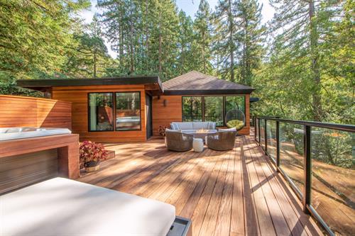 Hillside Wood Deck with metal framed glass railing