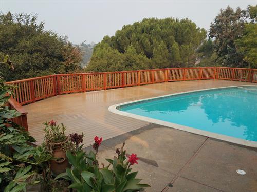 Trex pool deck with wood railing in San Rafael
