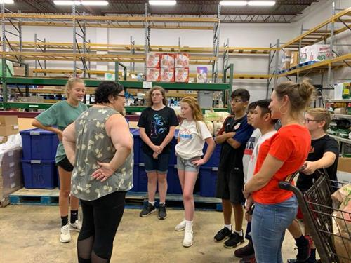 Touring the Food for Others warehouse to see where diapers are distributed