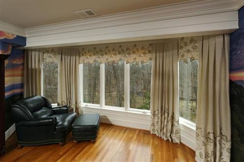 A woodland view led to a nature-inspired custom window treatment, and won an award in 2012.