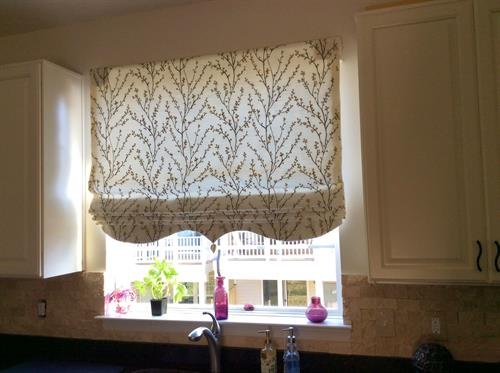 Roman shades are very functional and popular.  This one has shaping at the hem.  Raised, a Roman shade functions as a valance.  Lowered, it offers privacy.