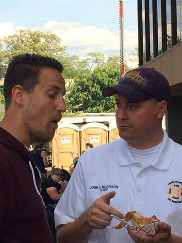 Fire Chief John Morrison is interviewed by Noah Cappe from Carnival Eats, Food Network