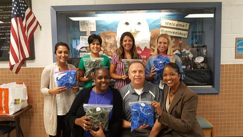 Happy Braddock ES staff upon delivery of 3D printed promotional items.
